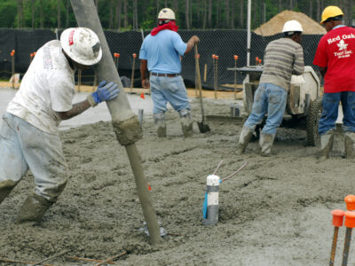 This is an image of a team of concrete contractors.